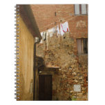 Clothes hanging to dry on a clothesline, spiral notebook