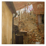 Clothes hanging to dry on a clothesline, ceramic tiles