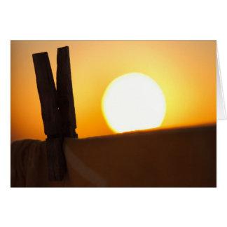 Clothes peg at sunrise greeting card