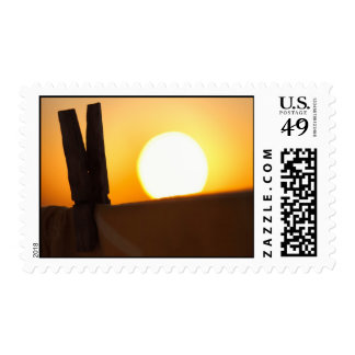 Clothes peg at sunrise stamps