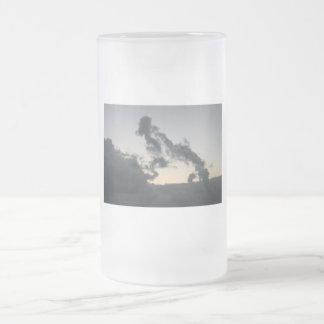 Cloud formation, dog skeleton? cartoon? frosted glass beer mug