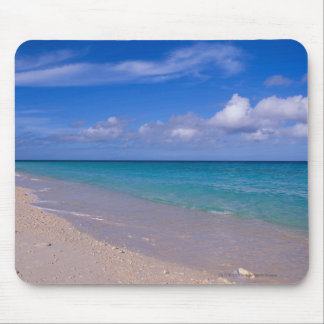 Cloud in blue sky over sandy beach mouse pad