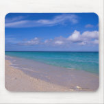 Cloud in blue sky over sandy beach mousepads