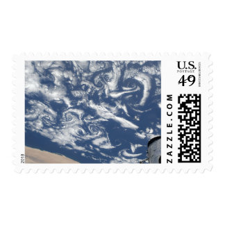 Cloud vortex streets off the coast postage