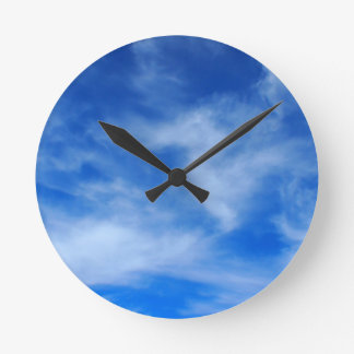 Clouds and sky are taking a picture round wallclocks