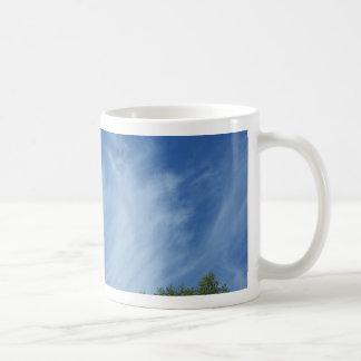 Clouds and trees coffee mug