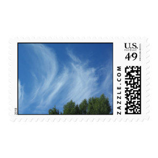 Clouds and trees postage stamp