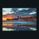 """Clouds at the Oceanside Pier Canvas Print<br><div class=""""desc"""">An unusual storm rushes through the Oceanside,  California area. Colors burst across the clouds and paint the old wooden pier. Oceanside is 40 miles North of San Diego,  California.</div>"""