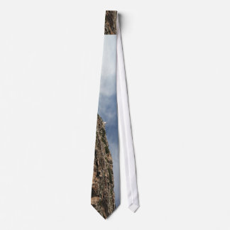 Clouds, cliff and calm water tie
