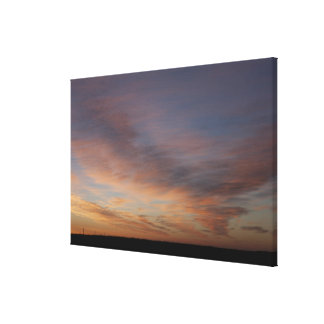 Clouds In An Orange Sky At Sunrise Stretched Canvas Print