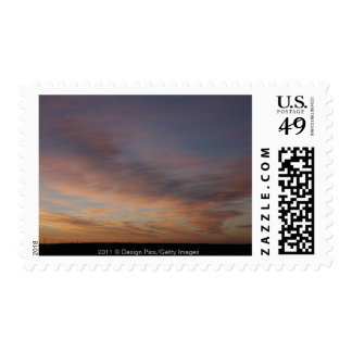 Clouds In An Orange Sky At Sunrise Postage