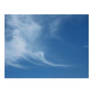 Clouds in blue sky postcard