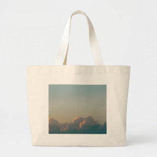 clouds in romania large tote bag