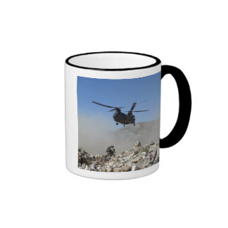Clouds of dust kicked up by the rotor wash ringer mug