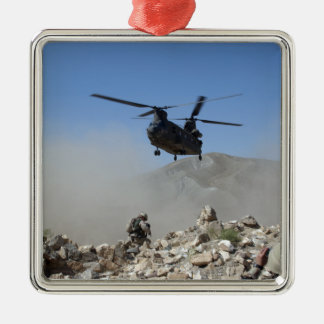 Clouds of dust kicked up by the rotor wash square metal christmas ornament
