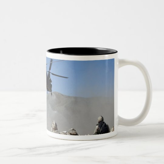 Clouds of dust kicked up by the rotor wash Two-Tone coffee mug