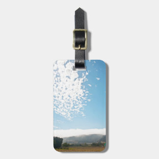 Clouds over a pasture tag for luggage