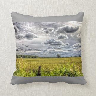 Clouds over Farm Fields Throw Pillows