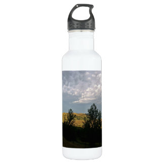 Clouds over mountains in summer evening stainless steel water bottle