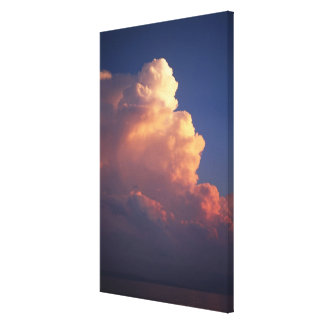 Clouds over sea at sunset canvas print