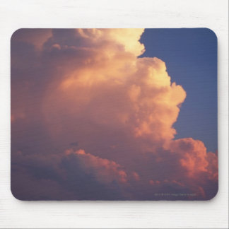 Clouds over sea at sunset mouse pad