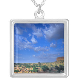 Clouds sweeping across the sky over the silver plated necklace