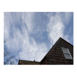 Cloudy Blue Sky over 100 year old home Postcard