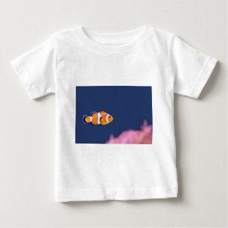 Clown fish swims in blue water with pink anemone baby T-Shirt