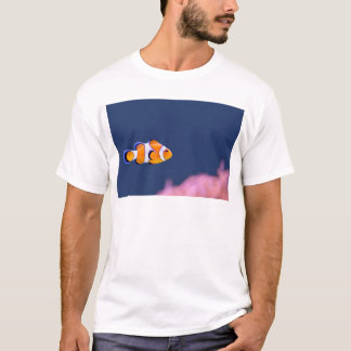 Clown fish swims in blue water with pink anemone T-Shirt