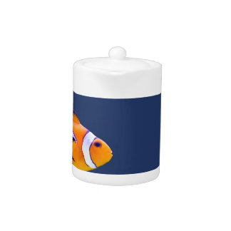 Clown fish swims in blue water with pink anemone teapot