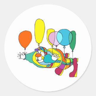 Clown flying by balloon round sticker
