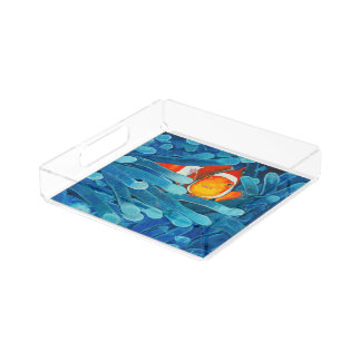 Clownfish en las anémonas de mar azules y el bandeja cuadrada