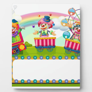 Clowns riding on train display plaque