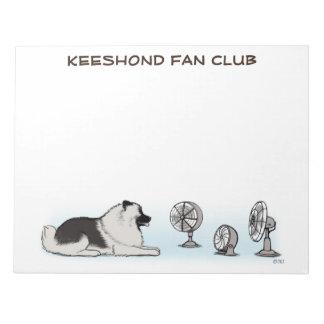 Club de fans del Keeshond - perro feliz con el Bloc De Notas