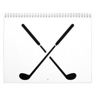 Clubs de golf cruzados calendarios de pared