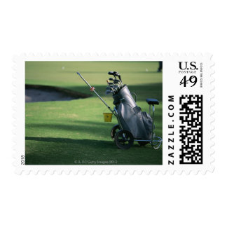 Clubs de golf y la bolsa de golf estampillas