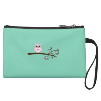 Clutch with whimsical owl on branch