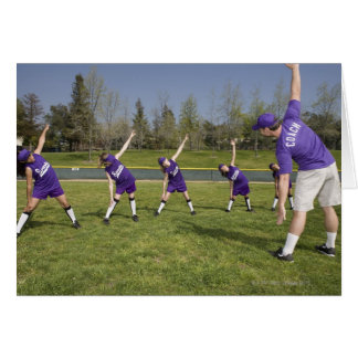 Coach and little league players stretching greeting cards