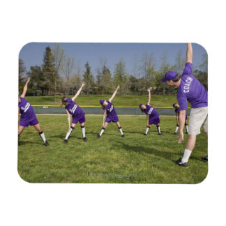 Coach and little league players stretching magnet