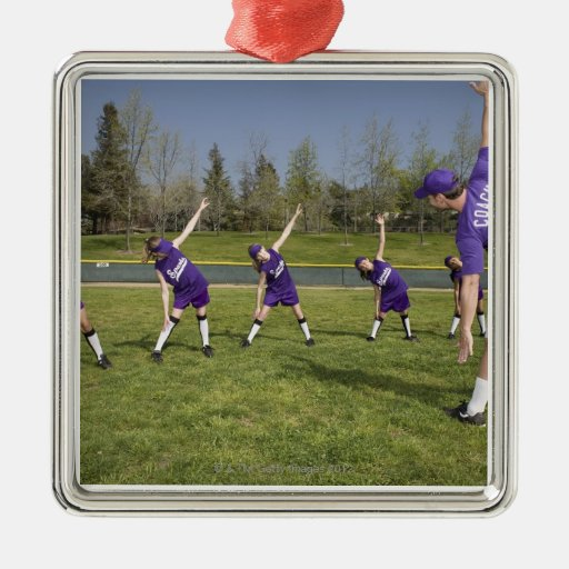 Coach and little league players stretching square metal christmas ornament
