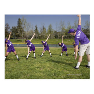 Coach and little league players stretching postcard