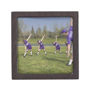 Coach and little league players stretching premium trinket boxes
