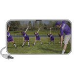 Coach and little league players stretching mp3 speakers