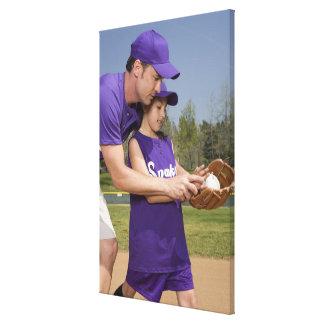 Coach teaching little league player canvas print