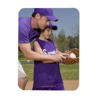 Coach teaching little league player magnet