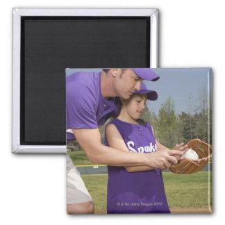 Coach teaching little league player magnets
