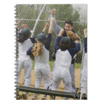 Coach with baseball team spiral note book