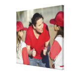 Coach with little league players stretched canvas print