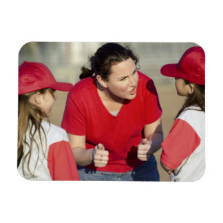 Coach with little league players magnet