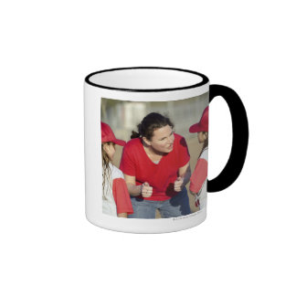 Coach with little league players coffee mugs